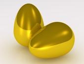 Dvě zlaté vejce na bílém pozadí