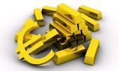 Koncept zlatých cihel spolu se zlatým symbolem eura