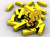 Několik zlatých cihliček na bílém pozadí
